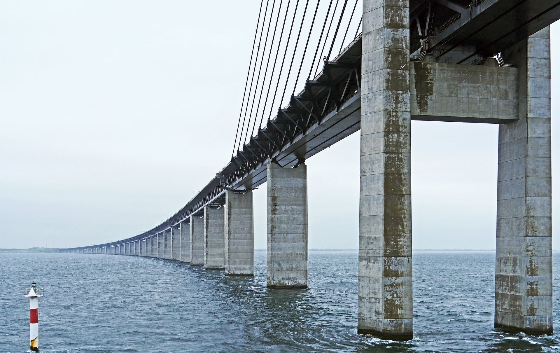 The Øresund Bridge spans the Øresund, a strait between Denmark and Sweden, and the narrowest point between the North Sea and Baltic Sea / Baltic Sea.