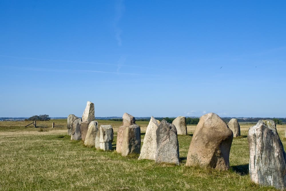 At Ales Stenar, fifty-nine stones stand neatly next to each other in the shape of a ship. Each stone weighs almost 2 tons, the material of the stones varies from granite to sandstone.