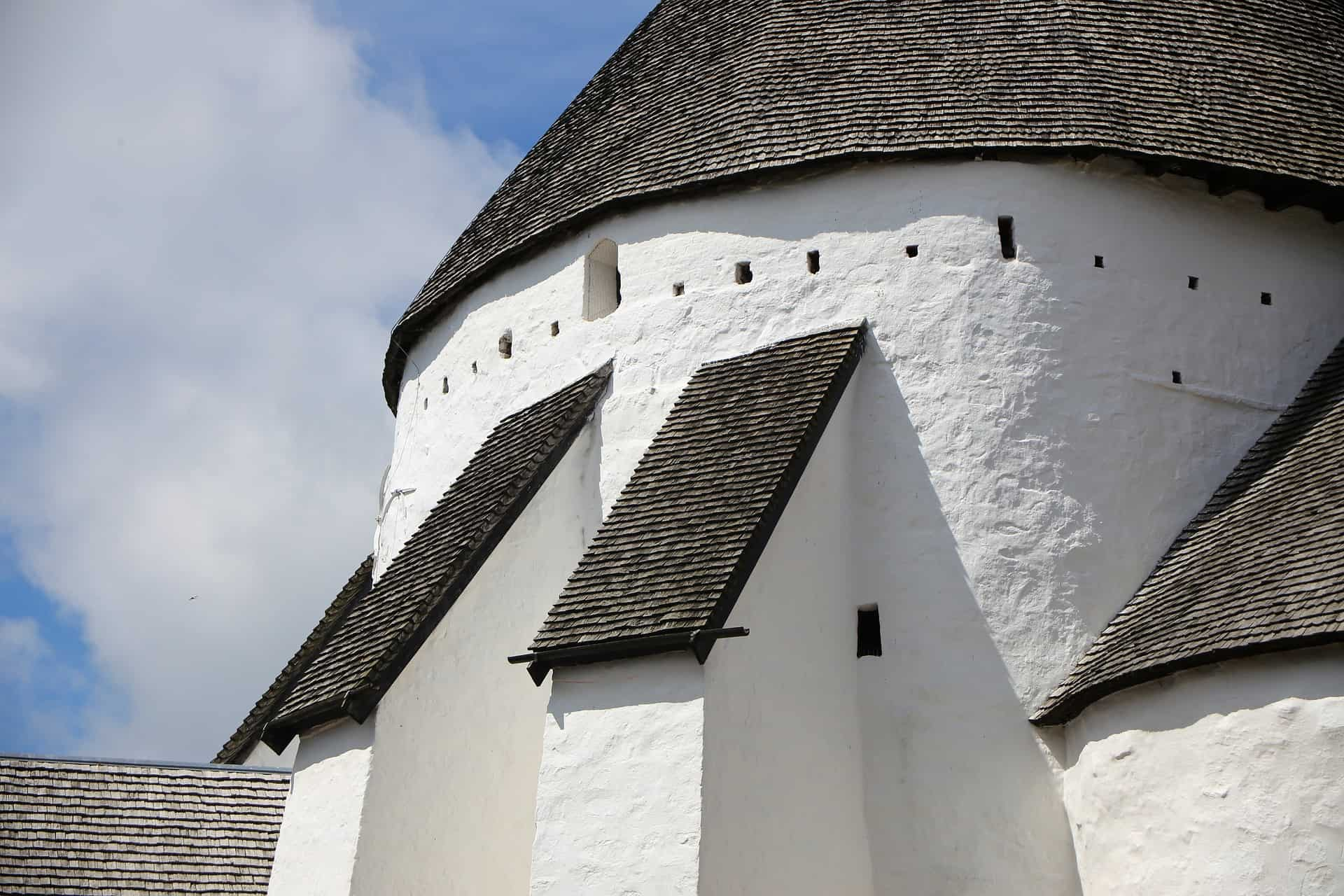 The Danish island of Bornholm is known for the unique centuries old white windmills and churches.