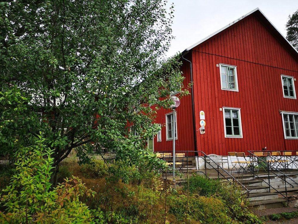 red wooden house in rural sweden