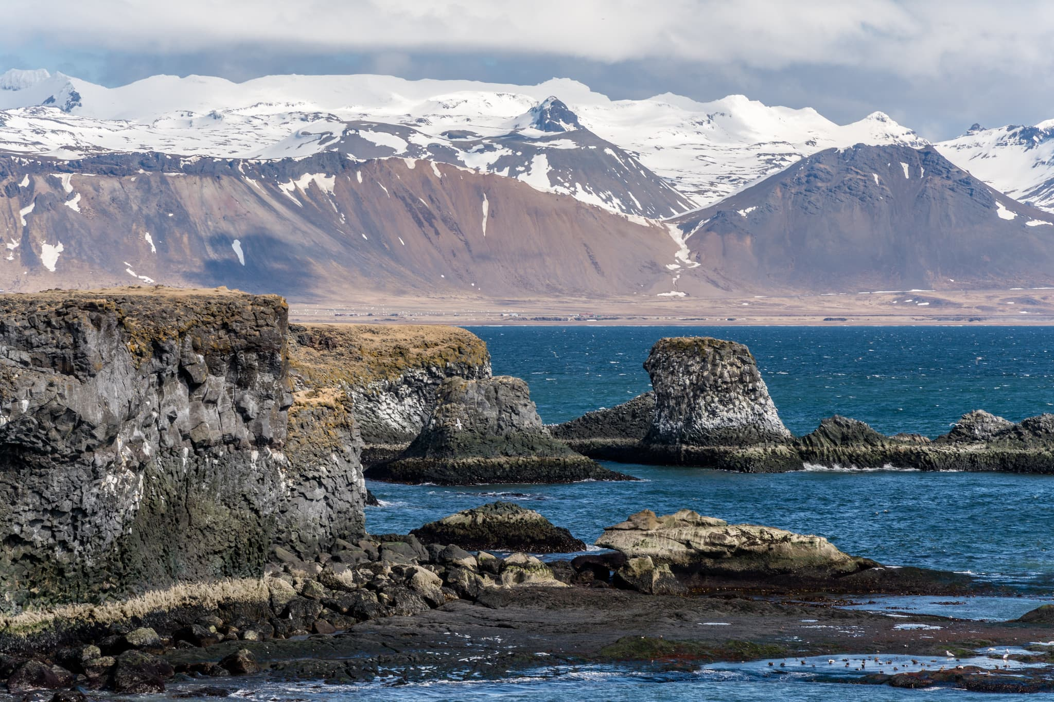 On the peninsula you will find volcanoes, lava fields, cliffs, black beaches, caves, basalt formations, waterfalls, lakes, hot and cold springs.